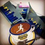 Marathon medal + pin! Photo Credit: Ratana